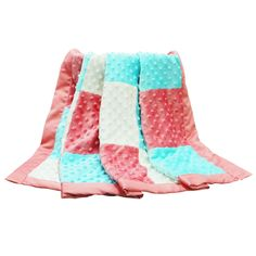 """The Peanut Shell Mila Blanket is a large blanket that measures 30"""" x 40"""" and features a traditional patchwork design in a striking coral, aqua, and white colorway. Made of super soft minky dot fabric, the Mila Blanket makes a beautiful gift! Coordinates with the Mila Nursery Collection."""