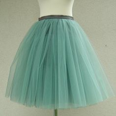 Mint tulle skirt, carrie bradshaw inspired tutu, sex and the city tutu... ❤ liked on Polyvore featuring skirts, tulle tutu, knee length tulle skirt, green tulle skirt, green tutu and green tutu skirt