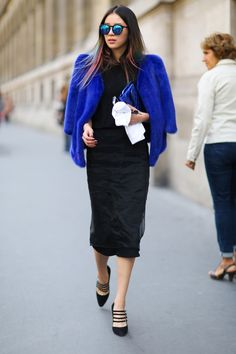 While donning head-to-toe black, the model incorporated color with a cobalt blue fur coat and matching clutch.