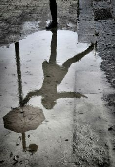 Black & White. umbrelal, water puddle, reflection photography