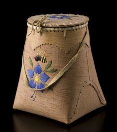 Birch Bark Berry Picking Basket (Bumble Bee design) by Alma Jumbo, Dené artist. Medium: Birch bark, spruce root, moose hide and dyed porcupine quills. Shown at Spirit Wrestler Gallery, Vancouver, BC.