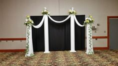 Wedding columns. Wedding backdrops. Diy columns. Yellow, white and gray wedding. Floral sprays in yellow and white.