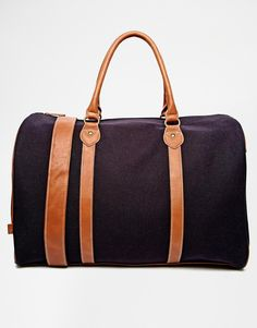 Maybe your lucky enough to be going on a business trip. So lets keep it classy with this smart canvas holdall. The leather trim makes it perfect to team with a suit and smart shoes.