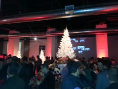 It's a sophisticated take on Christmas for the Tedd Bear Party in a custom lighting and floor plan design from Dallas Light and Sound. Video projection of the sponsor reel for the event shows behind one of two winter white Christmas trees that tower above the crowd of more than 450 patrons.