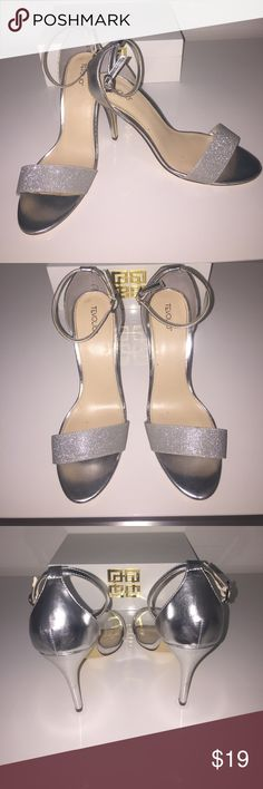 Tevolio: Metallic Silver/Glitter Ankle Heels, 8.5 Excellent condition! Worn once indoors. Very small dents on heel as pictured. Perfect for a special occasion such as wedding or prom! 👍🏽👍🏽 Save and bundle! 💰 Thanks for stopping by! 💕☺️ Tevolio Shoes Heels