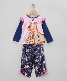 These pajamas were designed for the sheep counters and pillow fortress architects. A cuddly construction and roomy fit have comfort covered, while Scooby sows the seeds for imaginative dreams. Includes top and bottoms100% polyesterMachine washImported