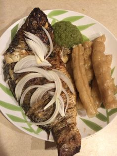 Baked Tilapia made by yours truly accompanied with Bobolo ( Cassava) and green habanero sauce #EasyRecipe #CameroonianDish #Fish #Bakedfish #tilapia