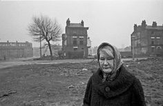 Woman amidst slum clearance, Liverpool 8, 1969. Homelessness charity Shelter is looking to find children and families featured in photographs of squalid 1960s housing conditions across Manchester, Liverpool and Sheffield.