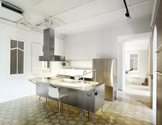 Apartment in Barcelona by Arquitectura-G featuring tiled floors