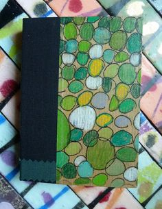 Green bubbles small blank book: cover is a draw-through monoprint enlivened with color pencil