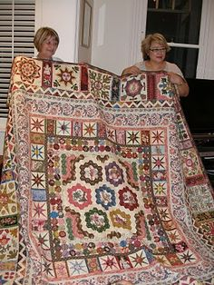 Love the top...you don't see too many any more with that extra pillow area...beautiful !  Kim McLean quilt
