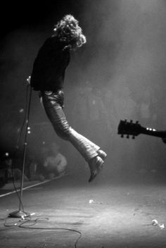 leap | music | guitar | jump | black  white | perform | sing it loud | smokey room | concert | festival | rock n roll | awesome | moment captured | suspended in time