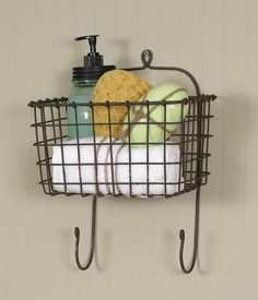 """Basket is 10"""" wide and 6"""" tall. The whole piece measures 15"""" tall. Hangs 8"""" deep. Mount this piece on the wall with two loops on the back. Accessories are not included."""