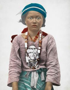 1334806. A Tinggian Igorot girl in traditional clothing poses for a portrait.