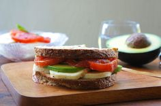 Caprese Sandwich With Avocado  Ingredients  2 (About 250 g) Buffalo Mozzarella Balls, sliced 2 Ripe Heirloom Tomatoes, sliced A Handful Basil Leaves, torn 2 Tbsp Extra Virgin Olive Oil Sea Salt to taste Freshly Ground Black Pepper Lemon Juice 1 Avocado, sliced 8 Slices of Country Grain Bread  Method  Combine the cheese, tomatoes, and basil in a mixing bowl, and season with olive oil, sea salt, black pepper and some lemon juice.   To assemble the sandwich: Layer cheese, avocado, ...