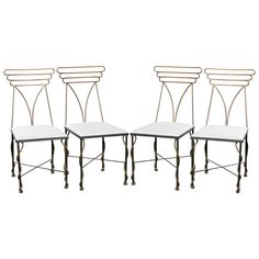Set of Four French Bronze Chairs | From a unique collection of antique and modern chairs at https://www.1stdibs.com/furniture/seating/chairs/