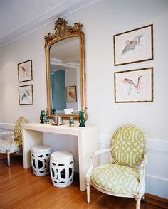 Furniture  French Photo - White garden stools and a gold mirror between a pair of upholstered chairs