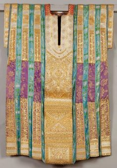 Tunisia | Wedding tunic ~ Qmejja ~ with ribbons of purple brocade, and embroidered with gold thread and decorated with sequins. | ca. late 19th century