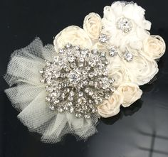 Bridal Hair Fascinator Clip in Ivory with Crystal Brooch and Chiffon Flowers- My Vintage adornment. $135.00, via Etsy.