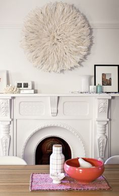 Perfect neutral art: a juju hat. A juju what? we're talking African Juju Hats. Designers are obsessed with these feather headdresses. Living Room Decor, Living Spaces, Juju Hat, Fireplace Mantle, Fireplace Facade, Fireplace Update, White Fireplace, Fireplace Ideas, Room Inspiration
