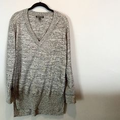 BR V-Neck Sweater Black/Grey Very soft and cozy sweater! Perfect with leggings and is meant to fit a little oversized. Has a slight high/low effect with slits up the sides (see pic). Great condition. Banana Republic Sweaters V-Necks