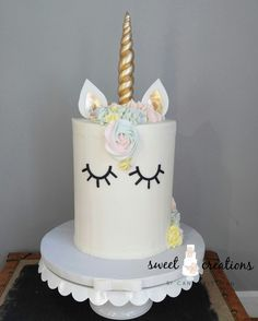 Vanilla confetti cake with strawberry preserves. Vanilla Buttercream with fondant eyes, ears and horn.