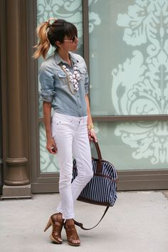 Pale denim shirt, heels, and white skinny jeans with white bubble necklace.