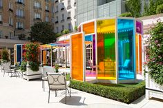 in the gardens of le bristol paris hotel, daniel buren has created 'une pause colorée - a chromatic and luminous landscape for guests to experience.