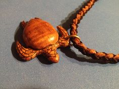 Hand carved Hawaiian Curly koa turtle necklace pendant. Sold $50