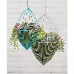 "<span class=""copyHeader"">hardwired.</span> Handcrafted of iron wire, hanging cage sculpture is powdercoated and welded into an airy home base for your favorite botanical.<br /><br /><NEWTAG/><ul><li>Handmade</li><li>Iron wire with powdercoat finish</li><li>Indoor or outdoor use</li><li>Wipe with a soft, dry cloth</li><li>Made in India</li></ul><br />"
