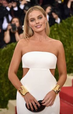 Met Gala 2016: best jewellery on the red carpet Margot Robbie wears Elsa Peretti 18ct gold bone cuffs by Tiffany & Co .... stunning!