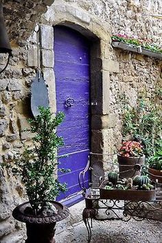 I love purple doors - there must be lots of beautiful colors inside this door too!