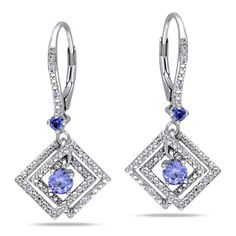 These attractive earrings by Miadora feature round-cut created tanzanite stones with round diamonds. The earrings are set in sterling silver and are secured with leverbacks.