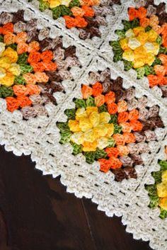 Receitas Círculo - Tapete Quadrados Floridos