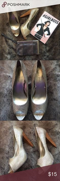 GIRLBOSS NINE WEST GOLD REPTILE PRINT PEEP TOE Bring out your wild side with these gold , reptile print peep toe shoes,!!! They are in euc, the inside are not perfect but not bad either, the sole , heels are in tact.. chic and elegant Nine West Shoes