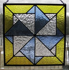 Twisting Star Stained Glass Panel by RedfordGlassStudio on Etsy, $95.00