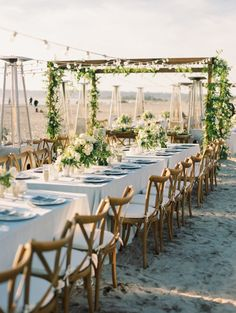 Dreamy floral filled beach reception: http://www.stylemepretty.com/california-weddings/coronado/2016/05/12/feel-the-sand-between-your-toes-with-this-beach-reception/ | Photography: Bryan N. Miller Photography - http://bmillerweddings.com/