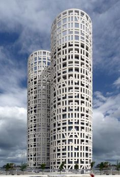 The Spanish architectural firm of Rafael de La-Hoz, designed the Torres de Hercules. The two cylindrical white towers are located in the Bay of Algeciras in Southern Spain