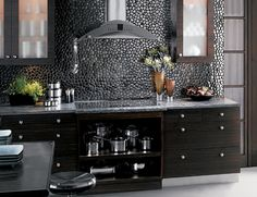 Metal freeform mosaics give the impression of pebbles.  I. LOVE. THIS. LOOK!