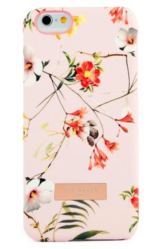 A dramatic layer of blooms brings lavish color to this vintage-style phone case from Ted Baker. So cute!