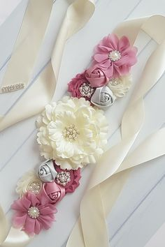 Our best seller is back! This gorgeous mauve and ivory floral maternity sash is the absolute favorite choice among new mothers for maternity photos. Get yours today! Maternity Sash, Maternity Photos, Pregnancy Photos, Rent Dresses, Aromatherapy Jewelry, Shoe Clips, Brittany, Mauve, Babyshower