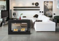 Don't know what kind of fireplace you could set up at home? Here are some design ideas you can inspire from to design the right fireplace for an impressive living room. Foyer Au Gaz Propane, Foyer Mural, Bioethanol Fireplace, Cosy Home, Freestanding Fireplace, Chula, Grey Flooring, Tile Flooring, Living Room Ideas