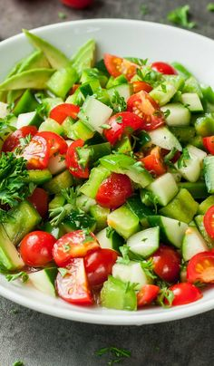This Healthy Tomato Cucumber Avocado Salad is light, fresh, and full of flavor! Gluten-free. Vegetarian. Vegan. DELICIOUS!