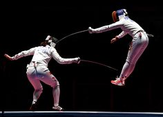 Ana Maria Popescu of Romania competes against Anqi Xu of China during the women's epee team gold medal match (1520×1100)