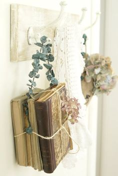 """Hanging Old Books w/ Flowers from Old Rack by Heather @ """"Post Road Vintage."""""""