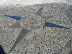 A circle was added to this paver patio complete with flagstone compass points.