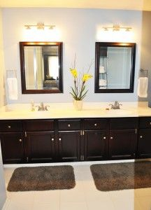This bathroom used to have a mirror from end to end.  We removed it and added two mirror, two lights, painted, and restrained the old light cabinets...looks BRAND NEW!