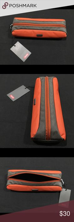 "Burnt Orange TUMI Toiletry Bag Burnt Orange TUMI Electronic Zipper Pouch / Toiletry Bag.  Dimensions:  10"" - Length 4"" - Width 2"" - Depth  Weight: 0 lbs. 5 oz.  Notes: The Burnt Orange TUMI Electronic Zipper Pouch / Toiletry Bag is in new/unused condition and may have damage to include missing accessories, missing/loose decals, scratching, dents, surface rust, stains, cracking, color fading, tape/sticker residue, and smudging to product or packaging. Tumi Bags Travel Bags"