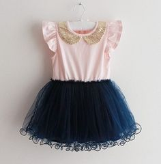 This dress is the sweetest! Features a navy skirt tulle tutu skirt,light pink top with adorned gold peter pan collar, also comes in navy top with white tutu skirt.   Pre-order. Ships in 12-18 days.