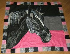 Hand pieced black, white, and hot pink horse quilt square. Made by my mama.